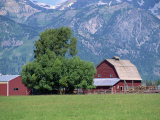 Farm Buildings with Mountain Slopes Behind, Jackson Hole, Wyoming, USA