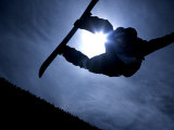 Silhouette of Male Snowboarder Flying over the Vert, Salt Lake City, Utah, USA
