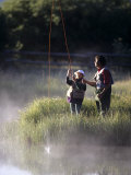 Father Fly Fishing with His Daughter