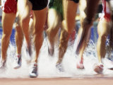Runners Legs Splashing Through Water Jump of Track and Field Steeplechase Race, Sydney, Australia