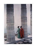Two Dancers in Costume Stand Between Columns of Poseidon