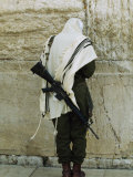 Israeli Soldier with Rifle Praying at the Wailing Wall