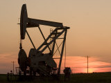Oil Drilling Pump Silhouetted Against the Sunset in North Dakota
