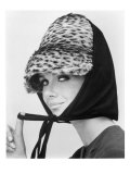 Nicole de la Marge in an Otto Lucas Jersey Scarf over an Ocelot Hat, 1964