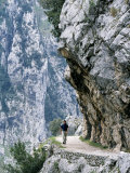 Trekker Walks the Trail Through the Cares Gorge, One of the Most Popular Walks in Spain