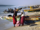 Mauritania, Nouakchott Fishermen Unload Gear from Boats Returning to Shore at Plage Des Pecheurs