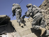 Soldiers Running Up Staircase of a Building During a Mission in Mosul, Iraq