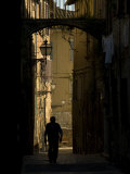 Man Walks Down a Narrow Street in Florence