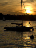 Sailboat Silhouetted on Lake Zurich at Sunset