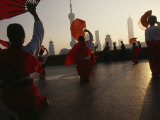 Women Exercise in the Morning by Fan Dancing on the Bund
