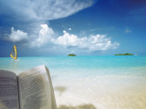 Reading Book on the Beach, Windsurfing and Islands in the Distance, the Maldives, Indian Ocean