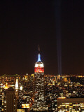 Empire State Building in Red, White and Blue as Columns of Light Soar from World Trade Center Site