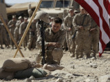 US Marine Pays His Respects to LCpl Joshua Bernard During a Memorial Service at Base in Afghanistan