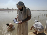 Members of Sabean Mandaeans Practice their Rituals on Banks of Tigris River in Baghdad, Iraq