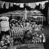 Housewife Marjorie McWeeney Amidst Symbolic Display of Her Week's Housework at Bloomingdale's