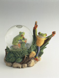 Close-Up of a Frog's Figurines with a Snow Globe
