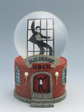Close-Up of a Figurine of Elvis Presley Dancing in a Snow Globe