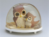 Close-Up of Figurines of a Pair of Owls in a Snow Globe