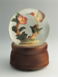 Figurine of a Hummingbird with a Flower in a Snow Globe