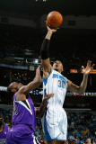 Sacramento Kings v New Orleans Hornets: David West and Carl Landry