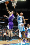 Sacramento Kings v New Orleans Hornets: Beno Udrih and David West
