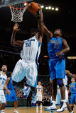 Dallas Mavericks v New Orleans Hornets: Brendan Haywood and Emeka Okafor
