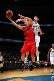 Toronto Raptors v Washington Wizards: Jose Calderon and Kirk Hinrich