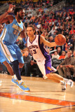 Denver Nuggets v Phoenix Suns: Nene Hilário and Steve Nash