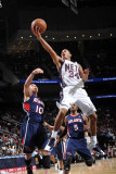 Atlanta Hawks v New Jersey Nets: Devin Harris and Mike Bibby