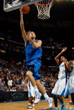 Dallas Mavericks v New Orleans Hornets: Dirk Nowitzki and Trevor Ariza