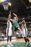 Milwaukee Bucks v Utah Jazz: Ersan Ilyasova, Al Jefferson and C.J. Miles