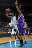 Sacramento Kings v New Orleans Hornets: Chris Paul and Carl Landry