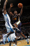 Utah Jazz v New Orleans Hornets: Paul Millsap and Emeka Okafor