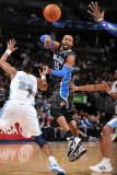 Orlando Magic v Denver Nuggets: Vince Carter and Shelden Williams