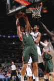 Milwaukee Bucks v San Antonio Spurs: Andrew Bogut and Tim Duncan Photographic Print