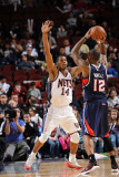 Atlanta Hawks v New Jersey Nets: Josh Powell and Derrick Favors