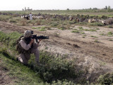 Soldier Scans the Distance with His Rifle's Scope While on a Knock-And-Talk Patrol in Zaidon, Iraq