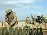 A US Marine Prepares Howitzer Rounds to be Fired Near Baghdadi, Iraq, January 6, 2007