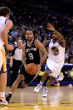San Antonio Spurs v Golden State Warriors, Oakland, CA - January 24: Tony Parker and Reggie William