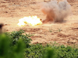 Ten Half-Pound Blocks of TNT Simultaneously Detonate at Camp Schwab's Demo Range Three