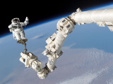 Buy Astronaut Anchored to a Foot Restraint on the International Space Station's Canadarm2 at AllPosters.com