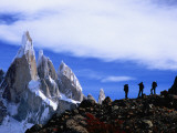 Hikers on a Ridge Dwarfed by Cerro Torre