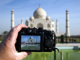 Tourist Taking Picture of Taj Mahal