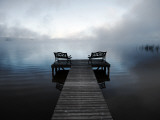 Chairs on Jetty on Mist Shrouded Lake
