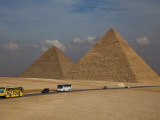 Tour Buses and Cars Driving by Pyramids of Giza