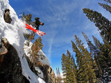 Skier Jumping Off Small Cliff at Brighton Ski Resort