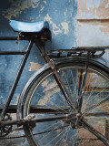 Bicycle Leaning Against Painted Wall Photographic Print