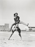 Couple Playing Leapfrog on Beach, Woman Jumping Over Man