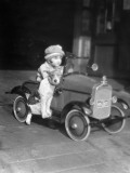 Girl in Toy Pedal Car With Dog Sitting on Running Board