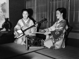 Two Japanese Female Musicians, One Playing Drum, the Other Playing Shamisen
